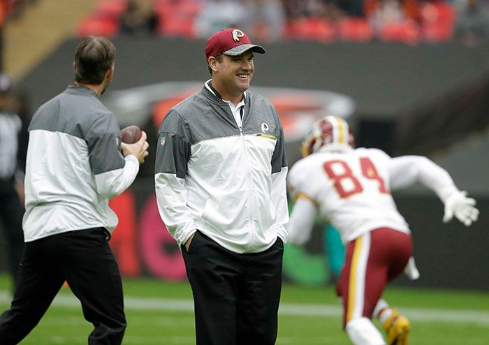 Redskins vs. Bengals:      October 30, 2016  -  TIE: 27-27  -      Head coach Jay Gruden smiles during the warm-up before the game. . (AP Photo/Matt Dunham)