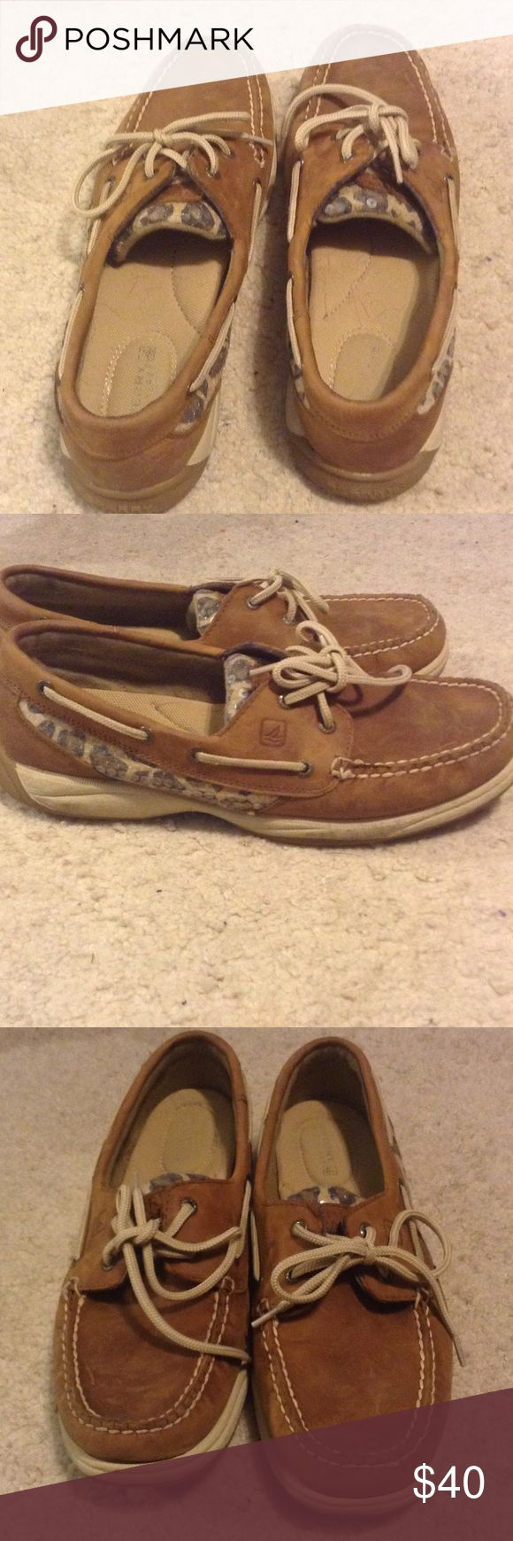 Sperry boat shoes Brown boat shoes with cheetah print accent on the side. Worn bust still in good condition. Shoes Flats & Loafers