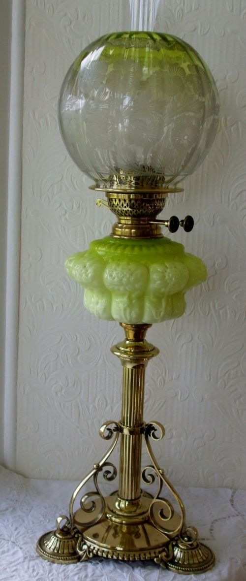 A really fine and attractive Late 19th Century Antique English Victorian Oil Lamp of unusual form, displaying distinct Arts and Crafts influence. The reeded column buttressed by three scrolling supports, and rising from a well designed beaded round brass base, mounted upon three decorative feet ~ applecrossantiques.com Ref. AVYGOL0318/SB