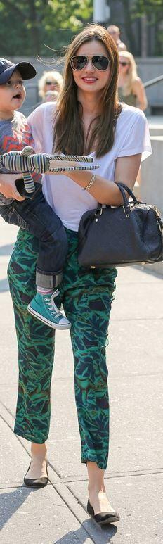 Miranda Kerr: Shoes – Givenchy  Pants – Bianca Spender  Purse – Louis Vuitton  Shirt – Isabel Marant