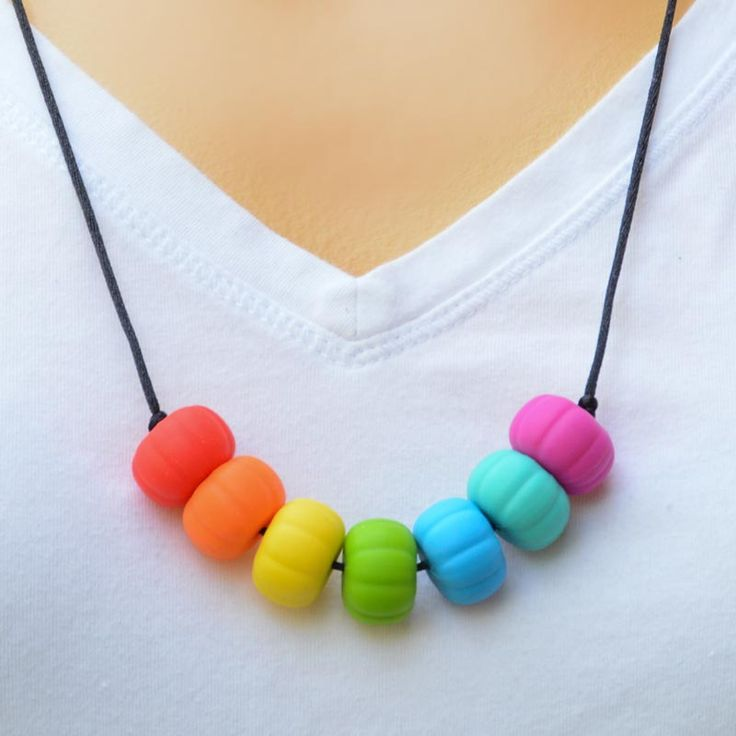 In Rainbows. A teething necklace for you to wear and your baby to chew.