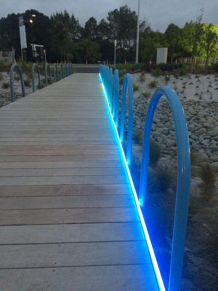 Dynamic LED NeonFlex illuminating a landscape bridge at the Tait Communications building in Christchurch. Controlled via a STICK DMX lighting show controller every 100mm section acts as a pixel and can produce millions of effects #LEDneonflex