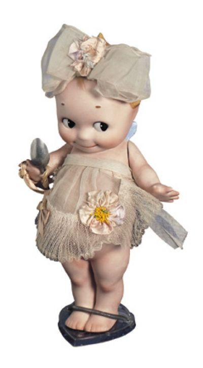 """9"""" German All-Bisque Kewpie~~~MARKS: O'Neill (feet). COMMENTS: Kewpie, designed by Rose O'Neill, circa 1915. VALUE POINTS: Large size model has excellent bisque, appealing antique costume."""