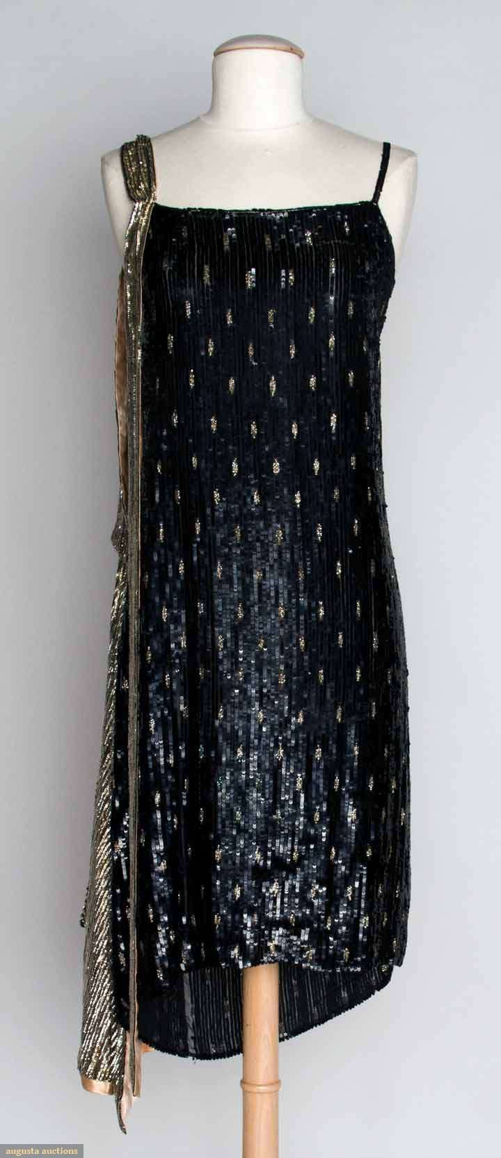 1920s straight sheath completely covered in small black sequins, inset w/pattern of small silver dashes, with a silver sequined scarf on left shoulder.