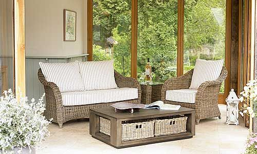 The chunky Islington range, with its stylish curves, is woven from grey wash kubu rattan. Very suitable for family rooms, conservatories and garden rooms, it is robust and hard-wearing. The base cushions are firm and comfortable and the seats have fibre back cushions. The occasional tables have glass tops for easy cleaning and a useful magazine shelf. You have a choice of fabrics in two price bands - it is shown here in Simla fabric. Special Offer: sofa and two armchairs (A fabric)  £1425