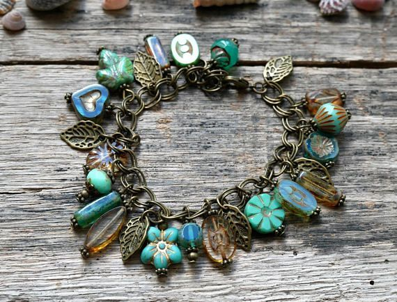 Pretty boho style turquoise, blue and Emerald bracelet. Double chain stitch ornate bronze metal with beautiful beads in turquoise, blue and Emerald Czech glass, shapes and varied appearance, small leaves and lobster clasp charms, bronze metal charm. Bohemian, retro style. This bracelet #MetalJewelry