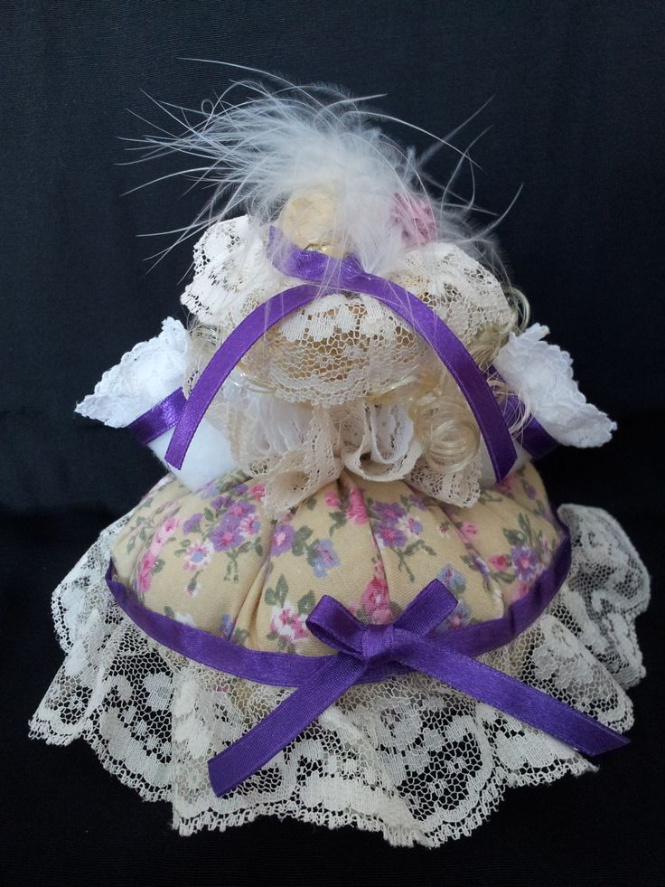 The Lady of Lavender Lane. Back view. Collectable Pin Cushion Doll. Material: Cotton & Lace. $25.00CAD + S/H if applicable. $0.00 Tax. Please contact Nola at: https://www.facebook.com/elegantcreationsbynola for purchase