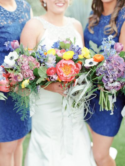 These bright blooms are so fun! http://www.stylemepretty.com/arizona-weddings/paradise-valley/2015/07/09/colorful-mexican-heritage-inspired-wedding/   Photography: Rachel Solomon - http://rachel-solomon.com/