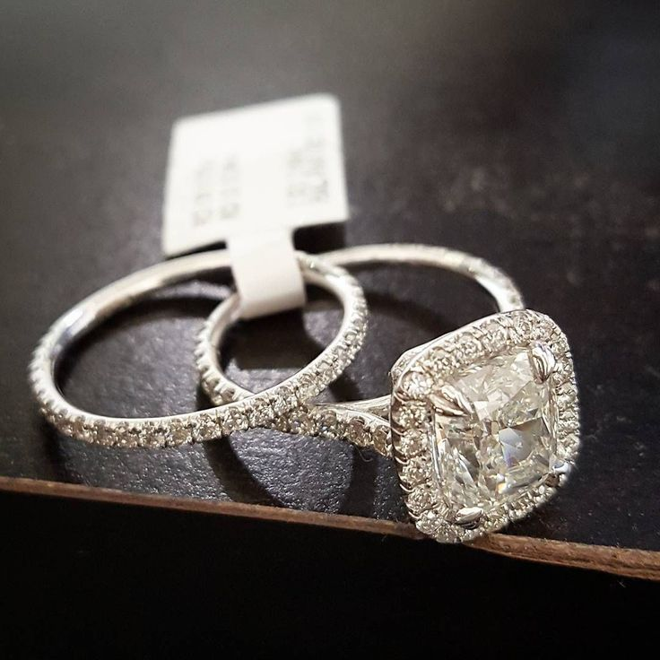 Cushion-cut halo diamond engagement ring with pave eternity wedding band. DIAMONDMANSION.com #weddingring