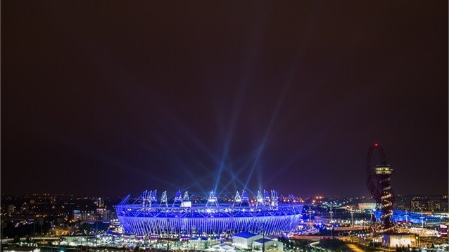 The Olympic Stadium is illuminated in stunning blue during the opening ceremony of the 2012 London Olympic Games.