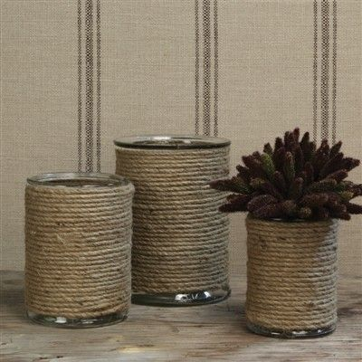 Twine wrapped cans. I also think leaving a bit of the can exposed could be a nice look!