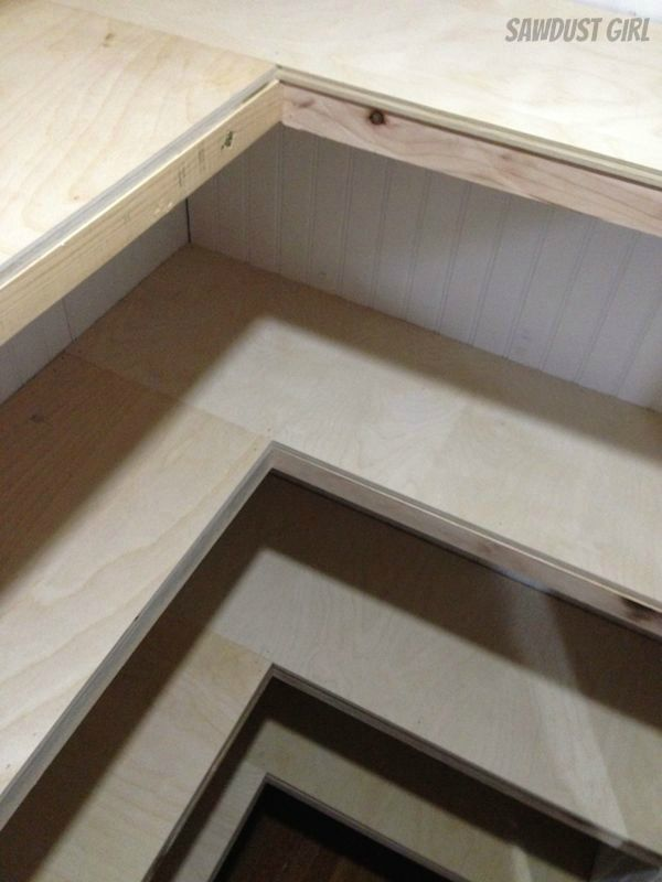 """How to build Floating Shelves 2x2's for cleats and braces, 1/2"""" plywood on top 1/4"""" plywood on bottom, 1x3 poplar face trim, bottom shelves are 14 inches deep and top shelves are 12 inches deep."""