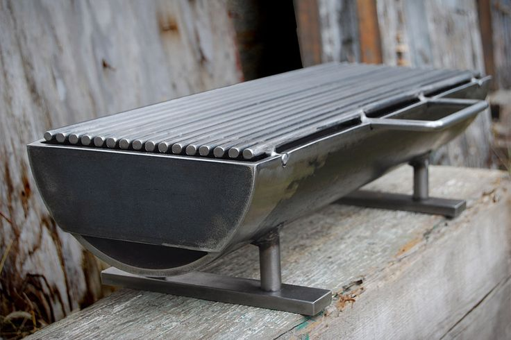 "THE HIBACHINATOR // Made from welded steel, it weighs in at a hefty 50 lbs., and offers a large, table-friendly 8"" x 24"" removable grilling surface, grilling bars that are close together to keep small morsels from falling through, and an optional stainless steel grilling top."