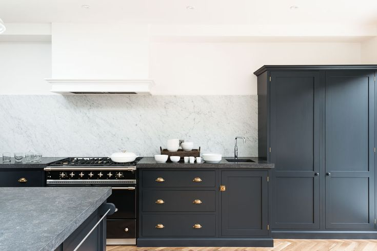 The Victoria Road NW6 Kitchen by deVOL, painted in 'Pantry Blue' with beautiful Belgian Blue Fossil worktops and a huge Carrara marble splashback.