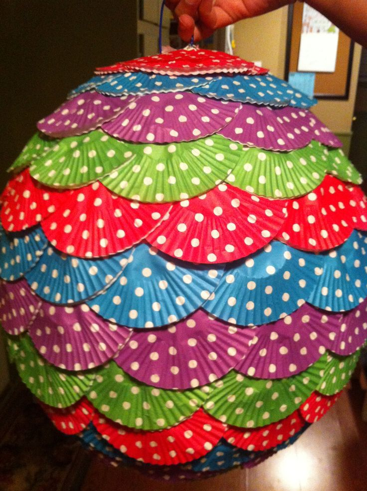 Pinata made out of cupcake liners DIY (I betcha I could find Christmas themed ones)