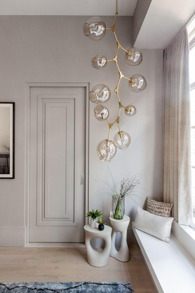 window nook | pocket door | modern pendant lighting | neutral color palette | interior design and style