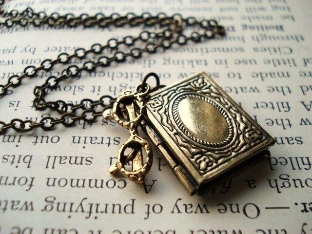 Book  Necklace, Locket in Antiqued Brass with Glasses Charm, Geekery, Librarian, Pendant Necklace, Nerd Jewelry. $18.00, via Etsy.