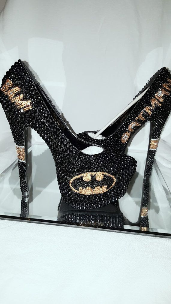 These Batman heels are truly Unique. They are all hand-made custom designed and you will not see this craftsmanship anywhere else. The shoes were done in a black pearl with golden yellow crystals of the highest quality. There is a large Batman symbol on the front of each shoe. On the