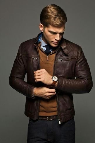 Men's Black Tie, Light Blue Dress Shirt, Brown Zip Neck Sweater, Dark Brown Leather Bomber Jacket, Dark Brown Leather Belt, and Black Chinos