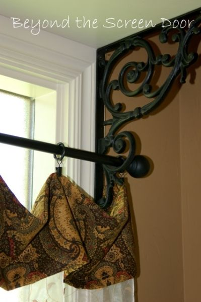 Shelf bracket used as curtain bracket.  A shelf can still be added for displaying pretty things. This room (in picture) does not have room above window, but most windows have plenty of room for a shelf.