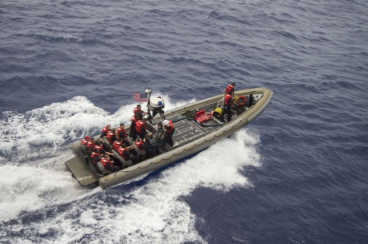 PHILIPPINE SEA (Sept. 21, 2016) Sailors ride a rigid-hull inflatable boat during a visit, board, search and seizeur exercise aboard the Whidbey Island-class amphibious dock landing ship USS Germantown (LSD 42) during Valiant Shield 2016. Valiant Shield 16 is a biennial, U.S. only, field training exercise (FTX) with a focus on integration of joint training among U.S. forces. Germantown, part of the Bonhomme Richard Expeditionary Strike Group with embarked 31st Marine Expeditionary Unit.