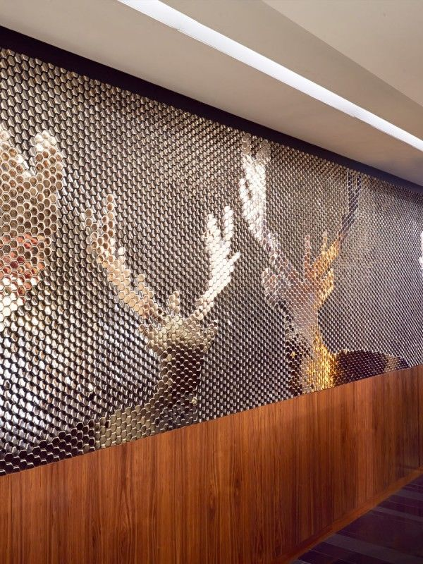 Silver Stag tiles mural for the Sheraton Hotel in Edinburgh by Giles Miller Studio. Feature wall / surface design studio based in London.