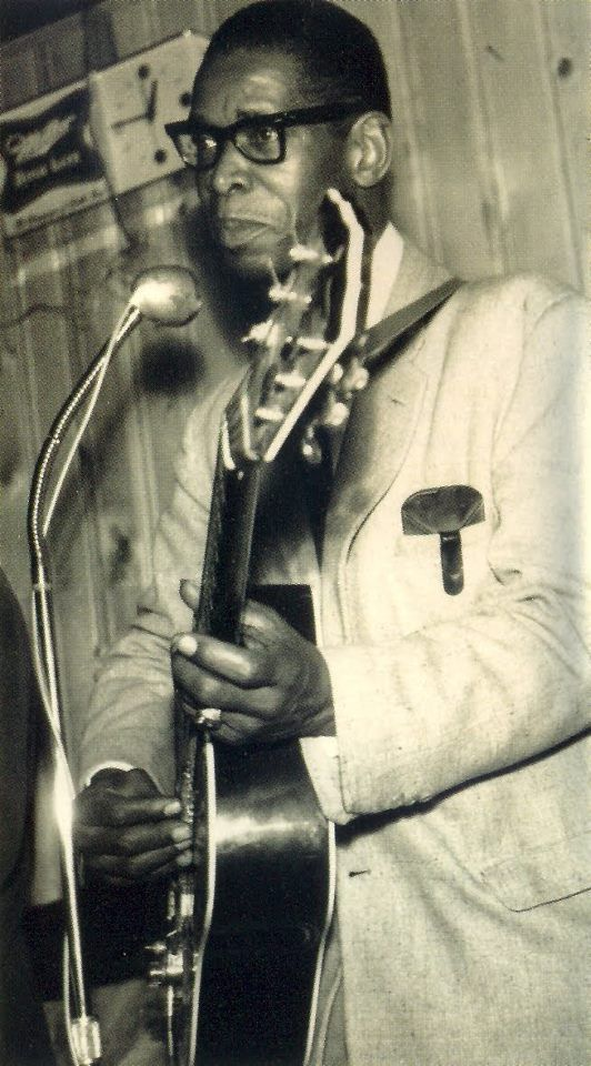 """Elmore James was born on a farm in Richland, Mississippi, on January 27, 1918. By the time he was 12, he was playing a one-string, wall-mounted """"guitar"""". He eventually moved to Jackson, Mississippi, where he ran a radio repair shop and played guitar at night and on weekends. One account has him playing with a band that included drums as early as 1939. If correct, that would place him several years ahead of Muddy Waters in blending Delta Blues with electrical amplification and percussion."""