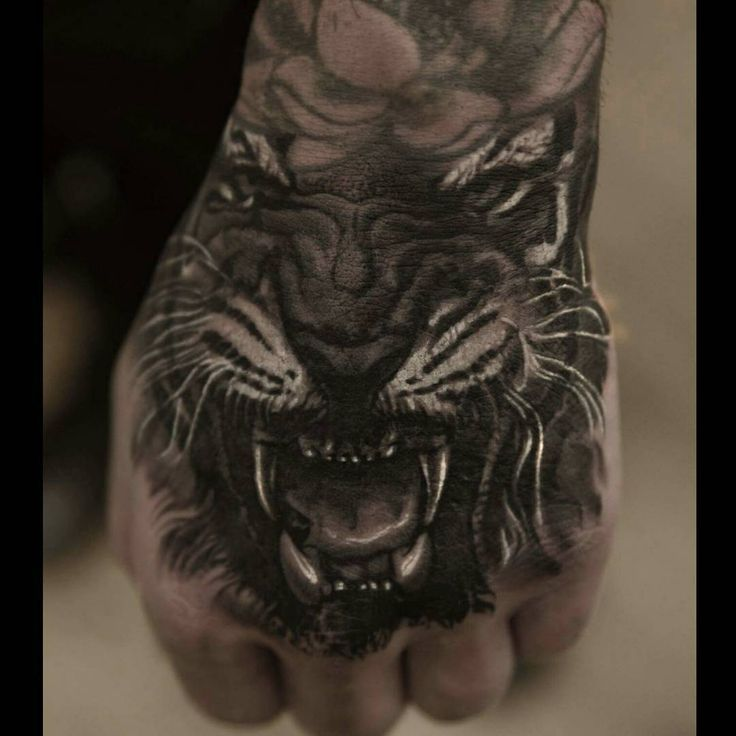 Tiger hand tattoo hand tattoo realistic tattoo hand for Finger lion tattoo