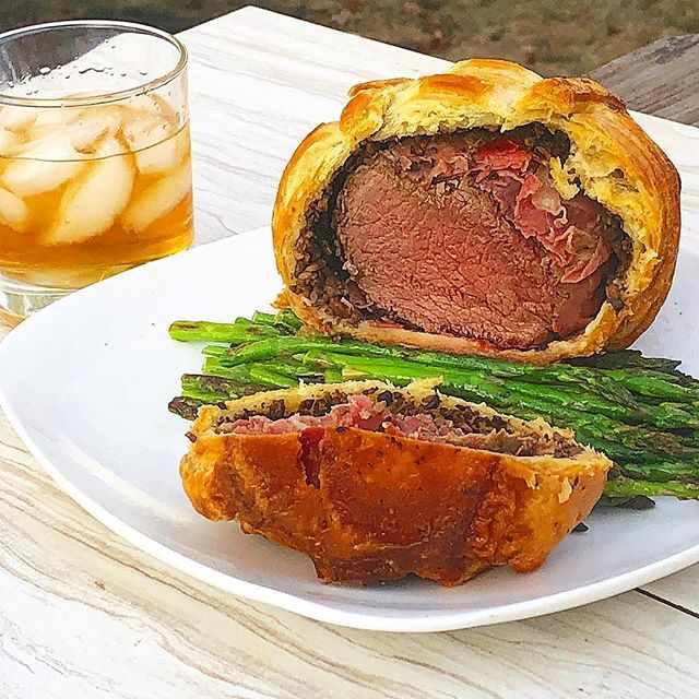 Ive been working on this dish for #MeatMadness which @traegergrills is putting on and am officially entering my version of #beefwellington #montanastyle to the contest! This dish took some time to make but was well worth the effort. I seared #beeftenderloin and allowed it to rest seasoned and wrapped tightly in the fridge overnight. Then I made a #mushroom #duxelle deglazed with #Pendleton whiskey. The meat was wrapped in #prosciutto and bundled with the mushrooms before being blanketed in…