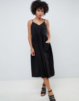 dadb1f47c55d5 Shop ASOS DESIGN casual smock midi cami dress at ASOS. Discover fashion  online.