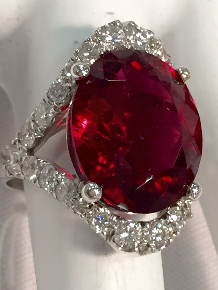 8ct rubellite tourmaline ring haloed and shanked with G,SI diamonds in 18k white gold.