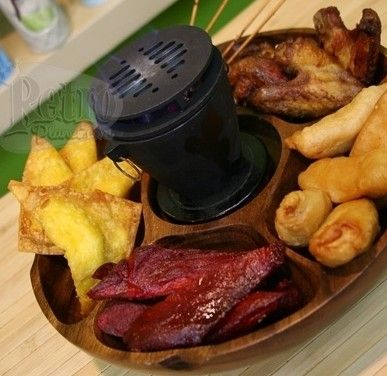 Practical Gifts: Pu Pu Platter with Hibachi.  How fun would THAT be?! ~K