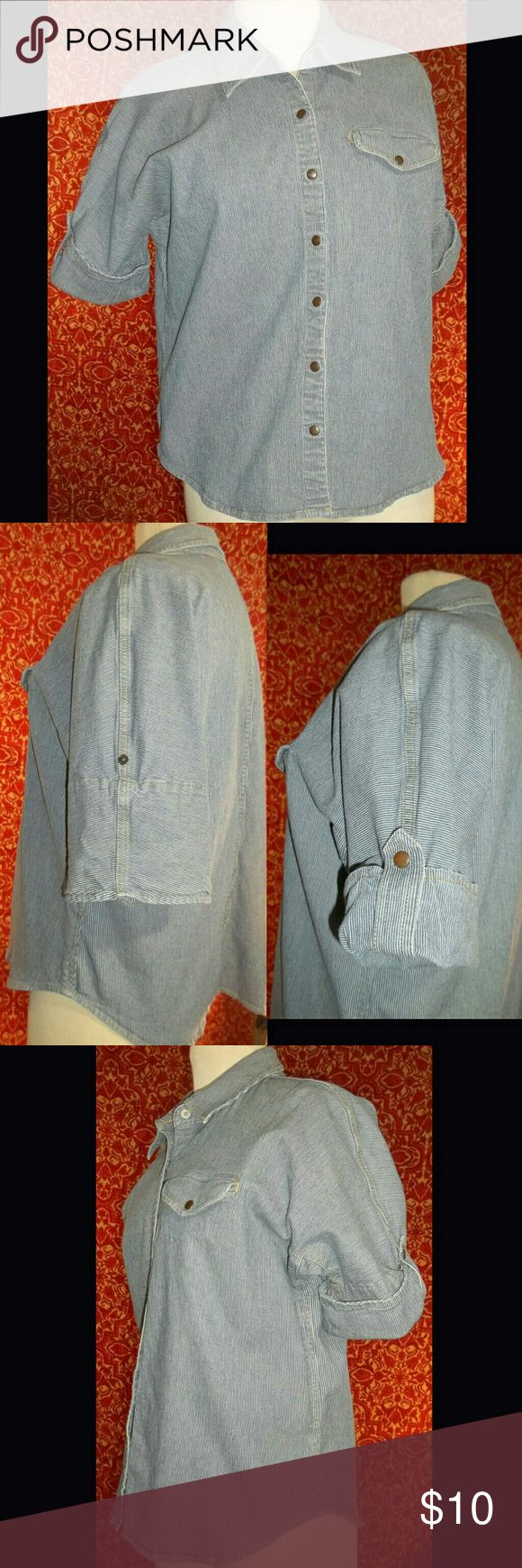 LIZ CLAIBORNE LIZWEAR PETITES batwing denim jacket Excellent condition, however posisble defect.  Underarm has ripples which resemble overstretch of the spandex, however this is present on back and front of each underarm which could mean this was by design..  Either way, does not take away from wear-ability.  Fabric is a med-thin coton denim with 2% spandex.  Snap front.  Domen/batwing almost safari style short sleeves with snap tab.  functionl single breast pocket. Liz Claiborne Tops…