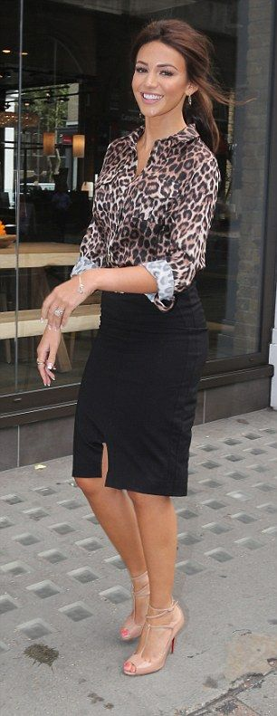 Animal instinct: Earlier on in the day, Michelle wore a leopard print blouse and skintight pencil skirt as she headed to the Lipsy offices