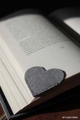 KAH says: Felt heart bookmarks. Simple and cute! I bet you could use interfaced fabric as well on the same idea.