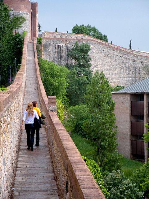 Bike Tour in Girona. Walking along Girona's city walls.