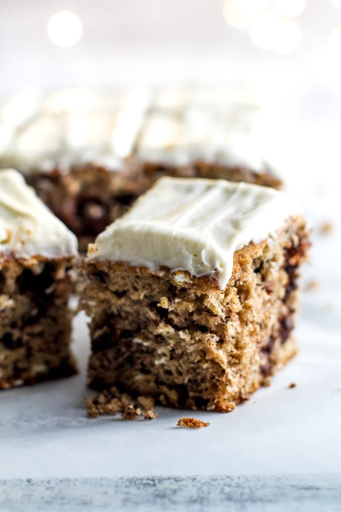 Healthy Banana Cake made without butter or oil, but so tender and flavourful that you'd never be able to tell. Topped with a lightened-up cream cheese frosting, this delicious banana-flavoured cake feels decadent but is actually surprisingly healthy   runningwithspoons.com