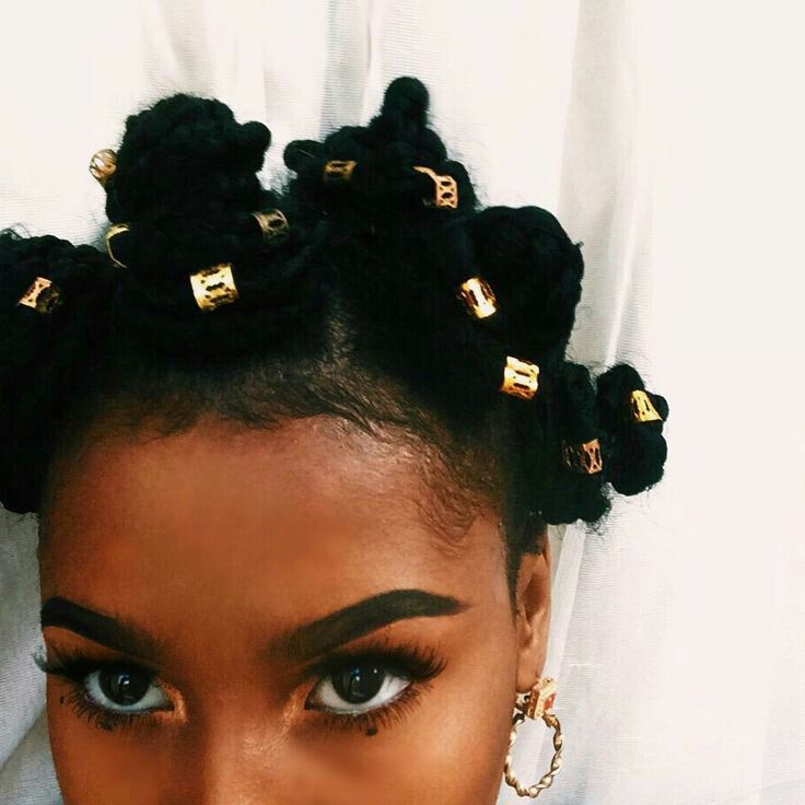 Gold beads in hair