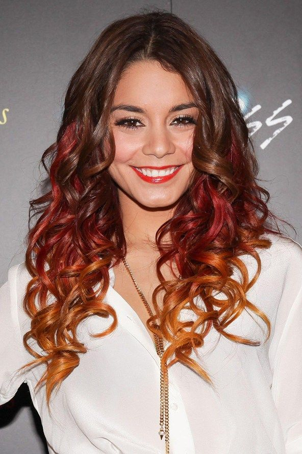 Don't be afraid to go daring with your dip-dye... Vanessa Hudgens mixes red and copper tones for this statement style.