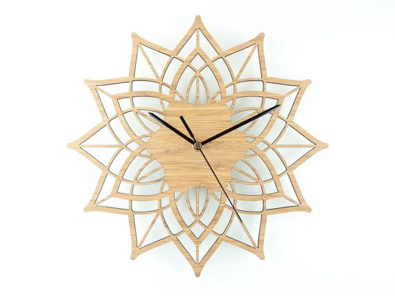This modern wall clock is called Contemporary Flower. The delicate design fits well in a modern or traditional home and the natural colour goes with