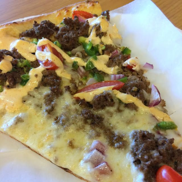 A zesty foldable slice of Taco at Taste of New York Pizza. So good it doesn't need ubiquitous tortilla chips as most others rely upon. Its not listed on the menu so my best guess on the build is crushed meatballs, fresh jalapeño, an alfredo base for toppings, along with mozzarella, red onion, grape tomato, and a cheesy drizzle.