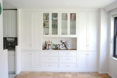 Idea for cabinetry to the right of the kitchen near the bay window. May not be able to do something this large, but could minimize it to just one set of feature glass cabinet doors