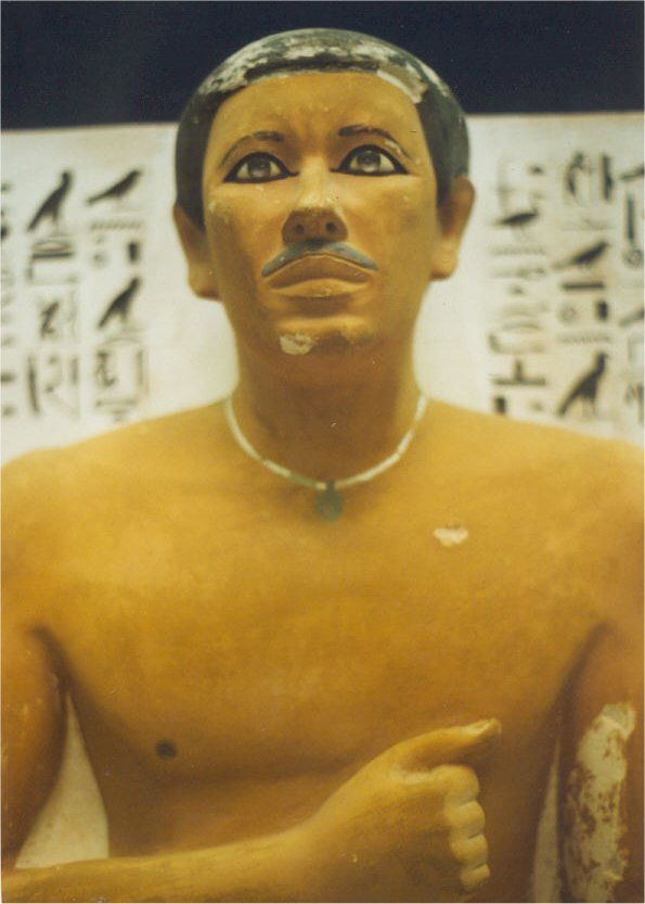 The Ra-Hotep statue violates a long list of clearly defined rules. A few of these rules are: Ra-Hotep is a royal son and high ranking official, but he does not wear a wig; he has a gray moustache; and he never had an emblem in his right hand across his chest.