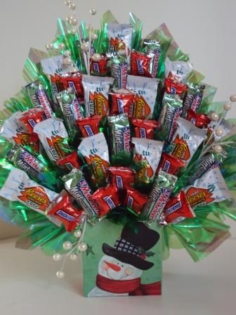 Snowman candy bouquet. This is so pretty with the iridescent cello and the beads. Love that they used the little candy bars and snack size candy.