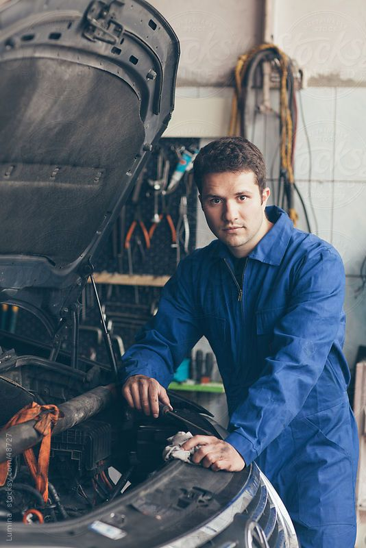 Mechanic Repairing a Car by Lumina