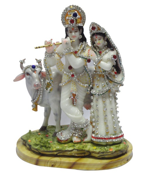 Radha Krishna - Very Attractive and decent loving pair of Radha ,Krishna Statue made from super quality of white marble highly studded with white and colored diamond swarovsky stones in their dress as well jwellery looking very pretty in standing position on green grassed mountain of marble with lovely pet cow and playing flute. very efficient use for all loving couples. Available at: www.giftzemporio.com