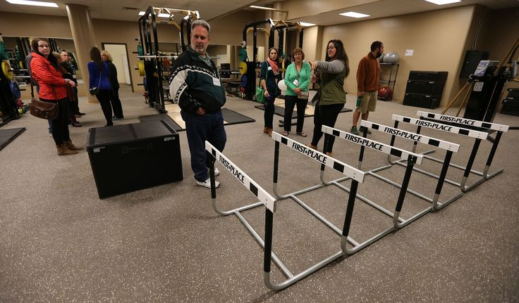 Visitors check out the Bison Football workout room at the University of Manitoba Kinesiology-Recreation, Bison Sports and Rec Services open-house event at Investors Group Field at the U of M on Sept. 26, 2013. Photo by Jason Halstead