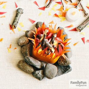Build a Tabletop Campfire: Craft a fire fit for indoor fun with tissue paper, battery-operated tea lights, and sticks and stones collected from outside.