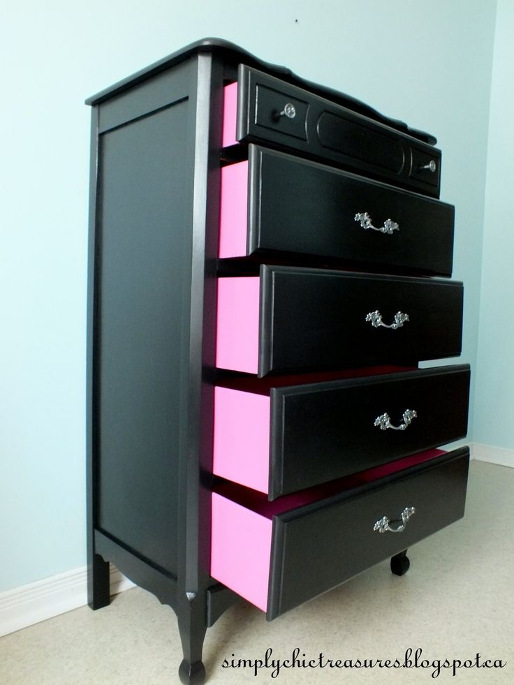 From the front this black dresser is chic and classic, but open up the drawers and look to the side and you'll find a surprise pop of color.