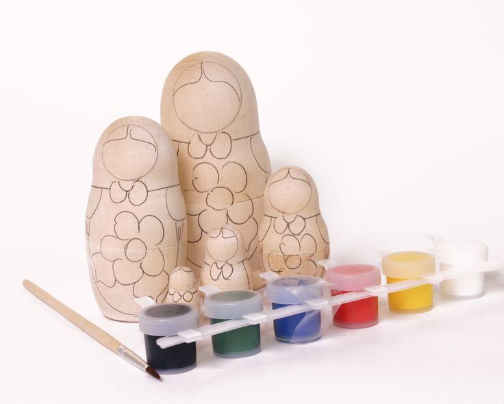 DIY Matryoshka painting kit with acrylic paint, brush and five nesting dolls